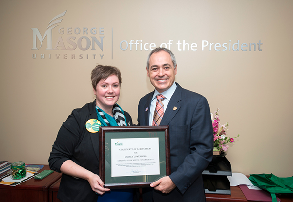 president cabrera presents lindsey lowenberg with employee of the month award
