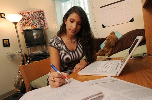 mason student doing classwork in dorm